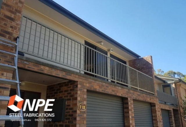 A balcony with metal balustrades.