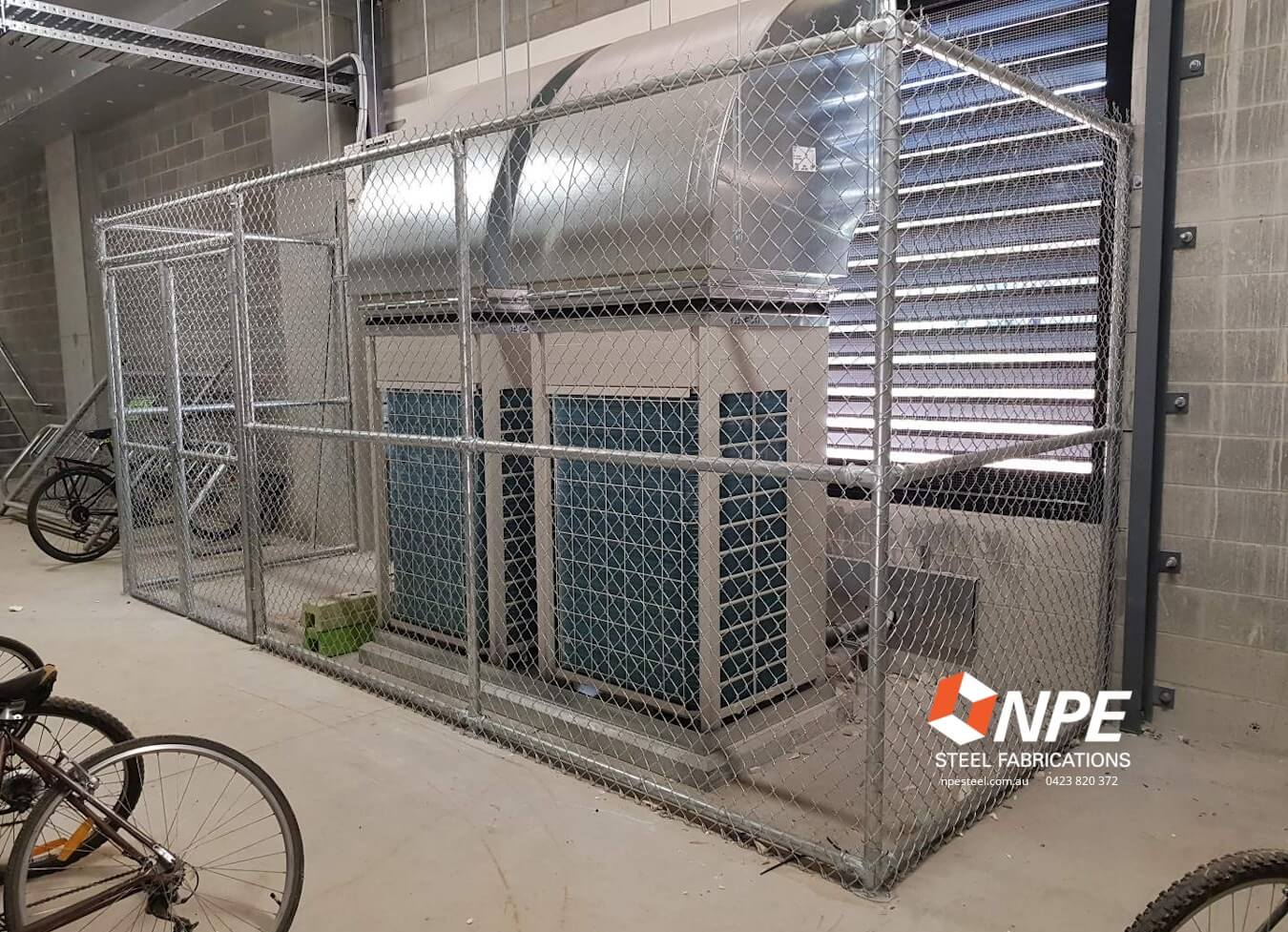 Fencing around part of a commercial / larger residential air conditioning system.